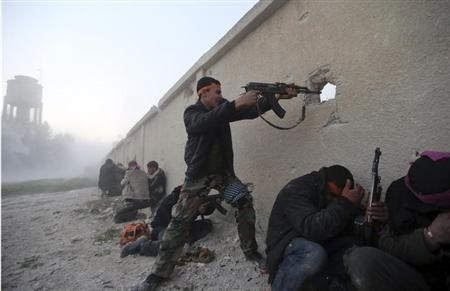 A Free Syrian Army fighter fires a rifle as he enters a Syrian Army base during heavy fighting in the Arabeen neighbourhood of Damascus February 3, 2013. REUTERS/Goran Tomasevic