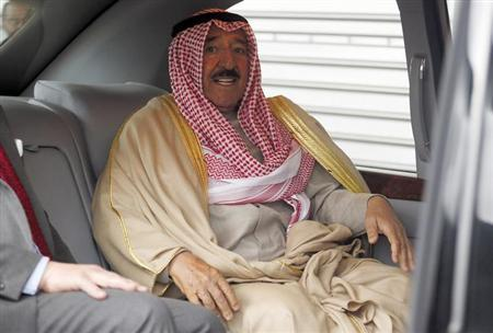 Kuwait's Emir Sheikh Sabah al-Ahmad al-Sabah sits in a car after arriving at Heathrow Airport in London November 26, 2012. REUTERS/Stefan Wermuth/Files