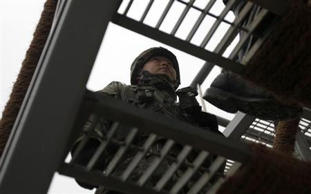 South Korean soldiers go up the stairs at a guard post, just south of the demilitarized zone separating the two Koreas, in Yeoncheon, about 65 km (40 miles) north of Seoul January 30, 2013. REUTERS/Kim Hong-Ji/Files