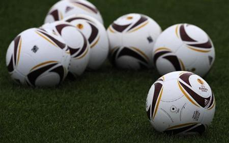 Europa league soccer balls are seen ahead of Manchester City's training session at the Carrington complex in Manchester, northern England September 29 2010. REUTERS/Nigel Roddis/Files