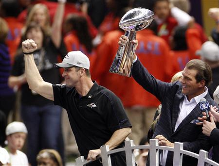 Baltimore Ravens head coach John Harbaugh (L) celebrates as team owner Steve Bisciotti holds up the Vince Lombardi Trophy after defeating the San Francisco 49ers in the NFL Super Bowl XLVII football game in New Orleans, Louisiana, February 3, 2013. REUTERS/Jonathan Bachman