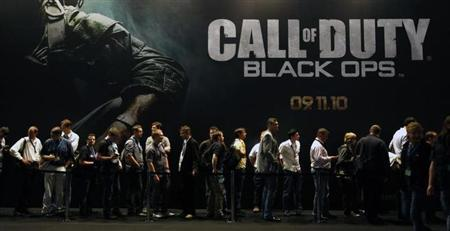 Visitors wait at an exhibition stand for 'Call of Duty - Black Ops' at the Gamescom 2010 fair in Cologne August 18, 2010. REUTERS/Ina Fassbender/Files