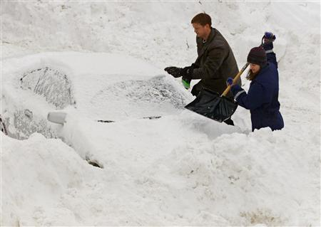 Residents of the Boston suburb of Medford, Massachusetts dig their cars out of the snow in this file picture. REUTERS/Jim Bourg