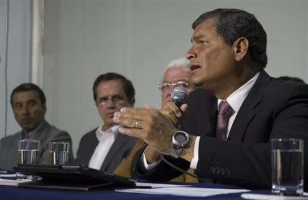 (L to R) Ecuador's President Rafael Correa addresses the media as Public Administration Secretary Vinicio Alvarado, Foreign Affairs Minister Ricardo Patino and National Assembly President Fernando Cordero look on, during a news conference in Quito February 5, 2013. REUTERS/Gary Granja