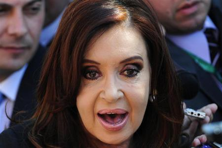 Argentina's President Cristina Fernandez De Kirchner speaks with the media as she attends the summit of the Community of Latin American, Caribbean States and European Union (CELAC-UE) in Santiago January 27, 2013. REUTERS/Jorge Sanchez