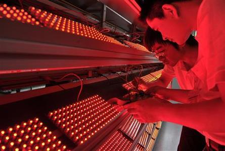 Employees measure the aging levels of low energy consumption LED light bulbs at a factory in Nanjing, Jiangsu province May 18, 2012. One in five Chinese LED lighting companies may fail this year as falling prices and oversupply batter an industry that Beijing bankrolled to try to build an energy-efficient future. Picture taken May 18, 2012. REUTERS/Sean Yong