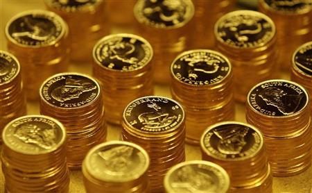 Gold bullion coins known as Krugerrands are pictured in the mint where they are manufactured in Midrand outside Johannesburg October 3, 2008. REUTERS/Siphiwe Sibeko/Files