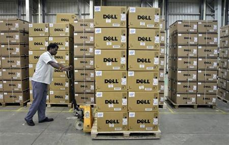 A man pushes a trolley full of Dell computers through a company factory in Sriperumbudur Taluk, in the Kancheepuram district of Tamil Nadu, in this June 2, 2011 file photograph. REUTERS/Babu/Files