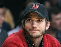 "Actor Ashton Kutcher sits courtside during Game 2 of the Los Angeles Lakers against Denver Nuggets NBA Western Conference quarter-final basketball playoff game in Los Angeles, California in this May 1, 2012 file photo. - Prosecutors charged a 12-year-old boy on Thursday with making a false emergency call that sent police swarming to the home of actor Ashton Kutcher in a ""swatting"" prank. REUTERS/Alex Gallardo"