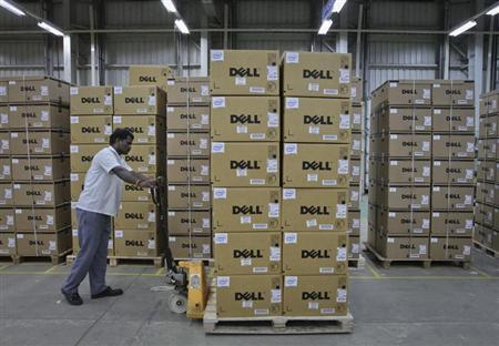 A man pushes a trolley full of Dell computers through a company factory in Sriperumbudur Taluk, in the Kancheepuram district of the southern Indian state of Tamil Nadu, June 2, 2011. REUTERS/Babu