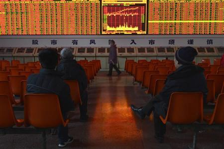 nvestors sit in front of an electronic board showing stock information at a brokerage house in Taiyuan, Shanxi province, January 14, 2013. REUTERS/Stringer/Files