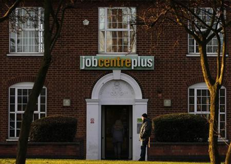 A man stands outside a state Job Centre employment office in Coalville, central England, December 14, 2011. REUTERS/Darren Staples