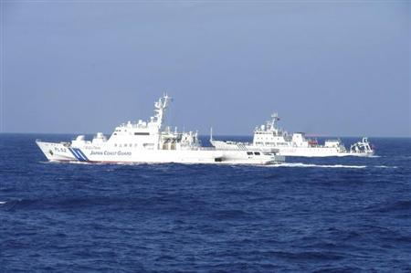 Chinese marine surveillance ship Haijian No. 51 (R) cruises next to a Japan Coast Guard patrol ship, Akaishi, in the East China Sea near the disputed isles known as Senkaku isles in Japan and Diaoyu islands in China, in this handout photo released by the 11th Regional Coast Guard Headquarters-Japan Coast Guard February 4, 2013. REUTERS/11th Regional Coast Guard Headquarters-Japan Coast Guard/Handout