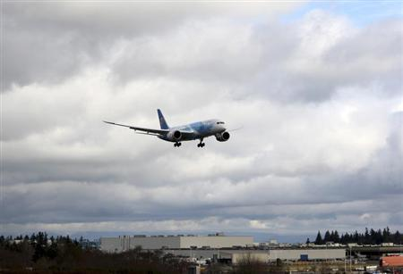 A Boeing 787 descends in Everett, Washington travelling with crew only from Fort Worth, Texas February 7, 2013. U.S. safety regulators must finish their investigation into Boeing's 787 Dreamliner before reaching conclusions about what improvements the Federal Aviation Administration should make, Transportation Secretary Ray LaHood and FAA head Michael Huerta said in a statement. REUTERS/Kevin P. Casey (UNITED STATES - Tags: TRANSPORT POLITICS BUSINESS)