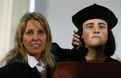 "Philippa Langley, originator of the ""Looking for Richard"" project, poses with a facial reconstruction of King Richard III at a news conference in central London February 5, 2013. REUTERS/Andrew Winning"