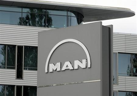 The logo of German industrial group MAN is pictured in front of the company's headquarters in Munich, September 18, 2006. MAN unveiled a 9.6 billion euro ($12.2 billion) cash-and-share offer for Scania AB, which the Swedish truckmaker and a key shareholder immediately rejected on Monday. MAN presented the deal as an avenue for two mid-sized rivals to combine to form Europe's truck-market leader, with a platform for global growth that would give it the economies of scale needed to compete against bigger rivals. REUTERS/Alexandra Beier (GERMANY)