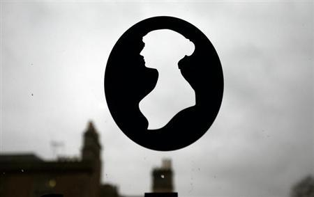 A silhouette of Jane Austen is seen in a window at the Jane Austen Centre in Bath, southern England January 28, 2013. REUTERS/Suzanne Plunkett