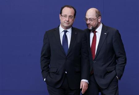 France's President Francois Hollande listens to European Parliament President Martin Schulz (R) as they pose for a family photo during an European Union leaders summit meeting to discuss the European Union's long-term budget in Brussels February 7, 2013. European Union leaders begin two days of talks on a long-term budget on Thursday, with efforts to refocus spending on growth likely to be thwarted by demands for farm subsidies as pressure to reach a deal grows. REUTERS/Francois Lenoir (BELGIUM - Tags: POLITICS BUSINESS TPX IMAGES OF THE DAY)