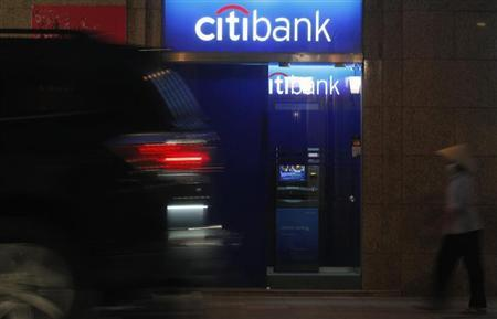 A woman walks past a branch of Citibank in Hanoi November 15, 2012. REUTERS/Kham