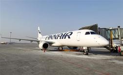 La compagnie aérienne finlandaise Finnair a renoué en 2012 avec les profits pour la première fois depuis quatre ans, grâce à une stratégie de réduction des coûts et un recentrage sur les vols long-courrier. /Photo d'archives/REUTERS/Peter Andrews