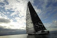 "Monohull ""Hugo Boss"", skippered by Britain's Alex Thomson and Spain's Guillermo Altadill, arrives in second place in the Jacques Vabre Transat yacht race from Le Havre, France to Puerto Limon, west of San Jose, November 18, 2011. REUTERS/Juan Carlos Ulate (COSTA RICA - Tags: SPORT YACHTING)"
