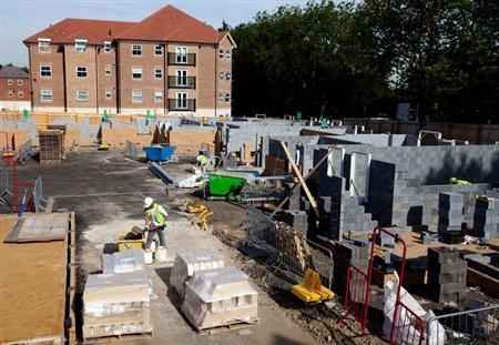 Workers construct residential homes at a building site in north London September 6, 2012. REUTERS/Neil Hall
