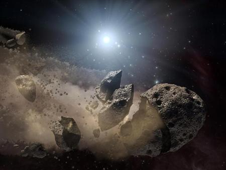 Image courtesy of NASA shows an artist's concept of a broken-up asteroid. Scientists think that a giant asteroid, which broke up long ago in the main asteroid belt between Mars and Jupiter, eventually made its way to Earth and led to the extinction of the dinosaurs. REUTERS/NASA/JPL-Caltech/Handout