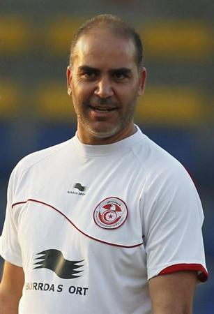 Tunisia head coach Sami Trabelsi smiles during a training session in Bongoville February 3, 2012. REUTERS/Louafi Larbi
