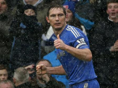 Chelsea's Frank Lampard celebrates after scoring a penalty against Arsenal during their English Premier League soccer match at Stamford Bridge in London January 20, 2013. REUTERS/Eddie Keogh