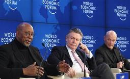 Pascal Lamy (R) , Director-General, World Trade Organization (WTO), EU Trade Commission Karel De Gucht (C) and U.S. Trade Representative Ron Kirk attend a session at the World Economic Forum (WEF) in Davos, January 28, 2012. REUTERS/Christian Hartmann