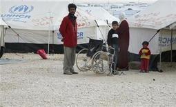 Unos 5.000 refugiados sirios están huyendo de Siria a diario, buscando refugio en los países vecinos, dijo el viernes el organismo para los refugiados de las Naciones Unidas. En la imagen, refugiados sirios en el campamento Al Zaatri de Mafraq (JOrdania) el 30 de enero de 2013. REUTERS/Majed Jaber