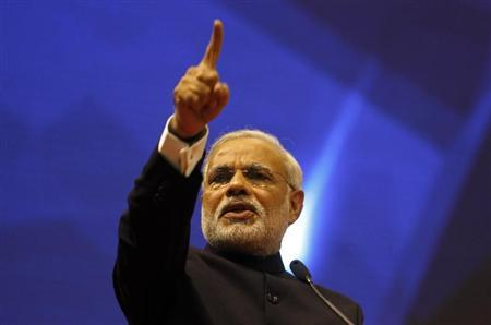 Gujarat's chief minister Narendra Modi speaks during the ''Vibrant Gujarat Summit'' at Gandhinagar in the western Indian state of Gujarat January 12, 2013. REUTERS/Amit Dave