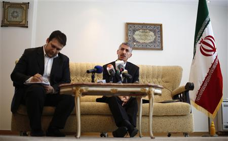 Iranian ambassador to Bulgaria Gholamreza Bageri (C) speaks to reporters during a news conference at the embassy building in Sofia February 8, 2013. REUTERS/Stoyan Nenov