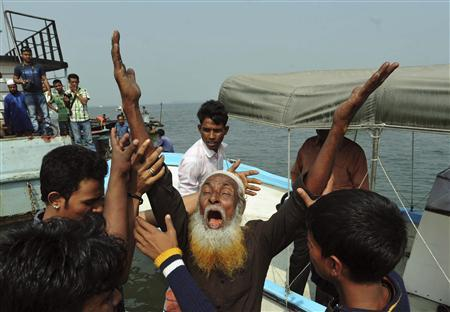 A relative of a missing passenger mourns after a ferry sank on giant Meghna river, in Munshiganj February 8, 2013. REUTERS/Khurshed Rinku