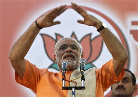 Narendra Modi, chief minister of Gujarat state, gestures as he addresses his supporters during a felicitation ceremony outside the party office in Ahmedabad December 20, 2012. REUTERS/Amit Dave/Files