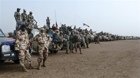 Hundreds of Chadian soldiers form a line with their vehicles in the northeastern town of Kidal, Mali, February 7, 2013. Around 1,000 troops from Chad led by the president's son advanced towards the mountains of northeast Mali on Thursday to join French search-and-destroy operations hunting Islamist jihadists. Picture taken February 7, 2013. REUTERS/Cheick Diouara (MALI - Tags: CIVIL UNREST POLITICS TPX IMAGES OF THE DAY CONFLICT)