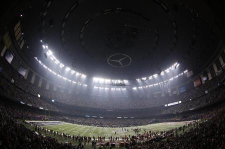 The Superdome is darkened during a power outage in the third quarter of the NFL Super Bowl XLVII football game in New Orleans, Louisiana, February 3, 2013. REUTERS/Jonathan Bachman