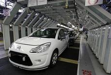 Citroen C3 automobiles are seen on the idled assembly line as striking employees prevent their colleagues from working at the PSA-Peugeot Citroen plant in Aulnay-sous-Bois, near Paris, February 4, 2013. REUTERS/Jacky Naegelen
