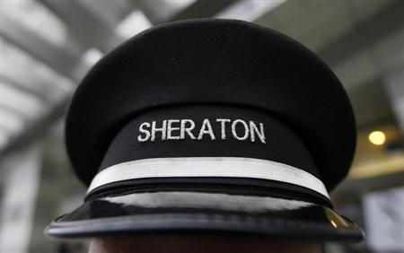A doorman's hat at Sheraton hotel, a brand of Starwood Hotels & Resorts Worldwide, is pictured in Warsaw February 24, 2012. REUTERS/Kacper Pempel