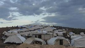 Syrian refugees are seen in a refugee camp on the Syrian side of the border with Turkey, near Idlib January 29, 2013, in this picture provided by Shaam News Network. Picture taken January 29, 2013. REUTERS/Muhammad Najdet Qadour/Shaam News Network/Handout (SYRIA - Tags: POLITICS CIVIL UNREST CONFLICT SOCIETY IMMIGRATION POVERTY) ATTENTION EDITORS - THIS PICTURE WAS PROVIDED BY A THIRD PARTY. REUTERS IS UNABLE TO INDEPENDENTLY VERIFY THE AUTHENTICITY, CONTENT, LOCATION OR DATE OF THIS IMAGE. FOR EDITORIAL USE ONLY. NOT FOR SALE FOR MARKETING OR ADVERTISING CAMPAIGNS. THIS PICTURE IS DISTRIBUTED EXACTLY AS RECEIVED BY REUTERS, AS A SERVICE TO CLIENTS