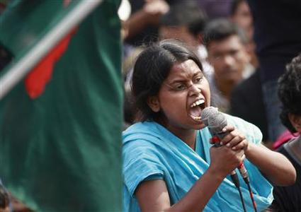 A student from the University of Dhaka shouts a slogan as she attends a mass demonstration at Shahbagh intersection, demanding capital punishment for Bangladesh's Jamaat-e-Islami senior leader Abdul Quader Mollah, after a war crimes tribunal sentenced him to life imprisonment, in Dhaka February 8, 2013. REUTERS-Andrew Biraj