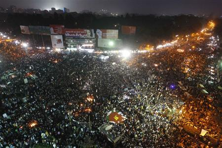 People attend a mass demonstration at Shahbagh intersection, demanding capital punishment for Bangladesh's Jamaat-e-Islami senior leader Abdul Quader Mollah, after a war crimes tribunal sentenced him to life imprisonment, in Dhaka February 8, 2013. REUTERS-Andrew Biraj