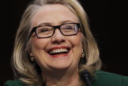 U.S.Secretary of State Hillary Clinton sits down to testify on the September attack on U.S. diplomatic sites in Benghazi, Libya during a hearing held by the U.S. Senate Foreign Relations Committee on Capitol Hill in Washington January 23, 2013. REUTERS/Kevin Lamarque