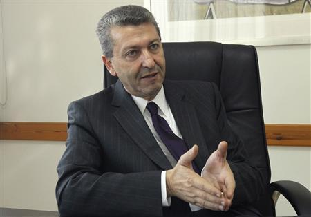Cyprus Presidential candidate George Lillikas gestures during an interview in Nicosia February 8, 2013. REUTERS/Andreas Manolis