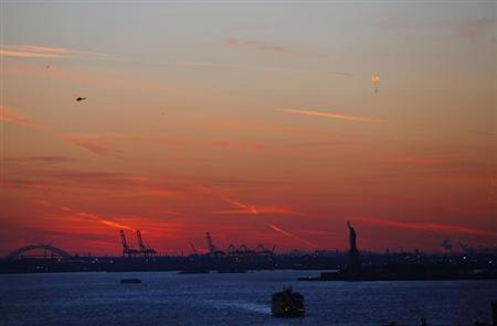 The Statue of Liberty is silhouetted against the evening sky in New York December 23, 2012. REUTERS/Joshua Lott