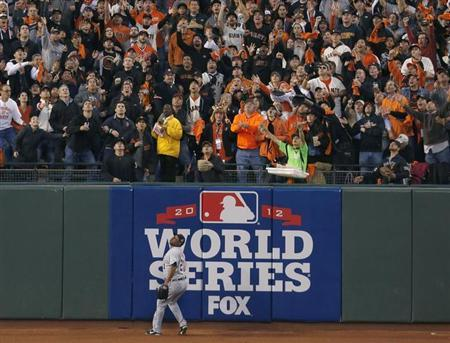Detroit Tigers' Delmon Young can only watch in the third inning as fans try to catch San Francisco Giants' Pablo Sandoval's second home run of the game during Game 1 of the MLB World Series baseball championship in San Francisco, in this file photo taken October 24, 2012. REUTERS/Stephen Lam