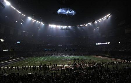 The Superdome field is covered in partial darkness during a power outage in the third quarter in the NFL Super Bowl XLVII football game between the San Francisco 49ers and Baltimore Ravens in New Orleans, Louisiana, February 3, 2013. REUTERS/Jonathan Bachman