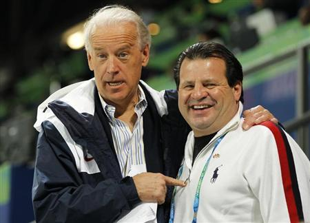 Vice President Joe Biden stands with 1980 Miracle on Ice legend Mike Eruzione at the women's U.S. vs. China hockey game at the Vancouver 2010 Winter Olympics, February 14, 2010. REUTERS/Scott Audette