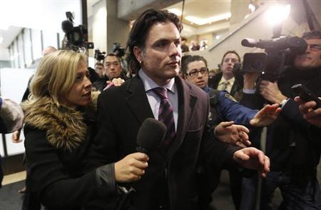 Senator Patrick Brazeau (C) leaves the courthouse in Gatineau, Quebec February 8, 2013. Brazeau has been charged with assault and sexual assault, according to local media. REUTERS/Chris Wattie