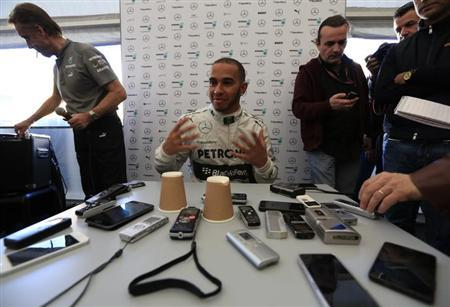 Mercedes Formula One racing driver Lewis Hamilton of Britain attends a news conference at the Jerez racetrack in southern Spain February 4, 2013. REUTERS/Marcelo del Pozo